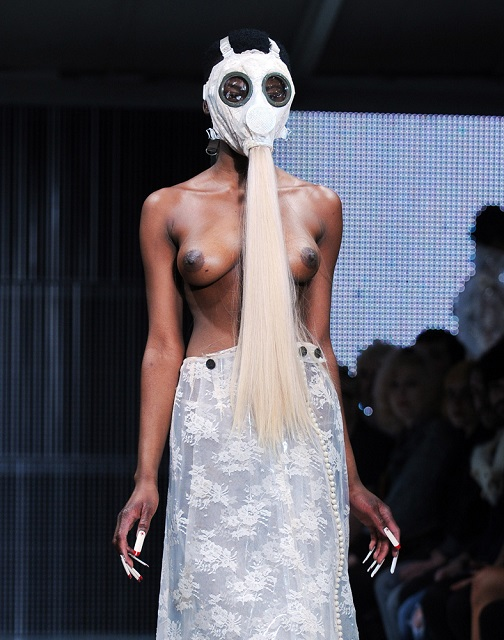 LONDON, ENGLAND - FEBRUARY 20: (EDITORS NOTE: Nudity) A model walks the runway at the Charlie Le Mindu Show at London Fashion Week Autumn/Winter 2011 at Mercer Studios on February 20, 2011 in London, England. (Photo by Samir Hussein/Getty Images)